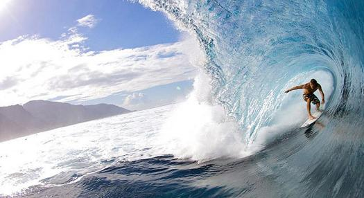 man surfing a wave in teahupoo in the island of Tahiti