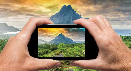 picture of a mountain inside a smartphone screen