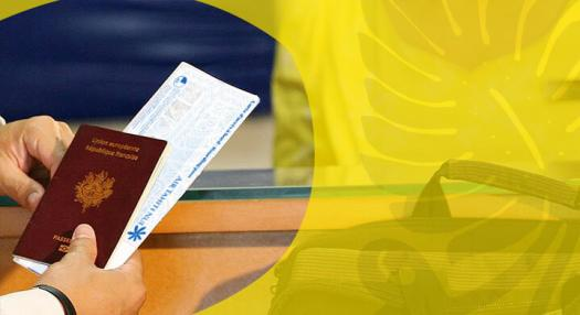 passenger giving tickets at check in desk