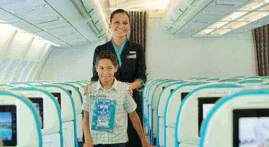 Unaccompanied kid stepping onboard Air Tahiti Nui flight