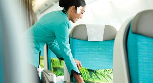 Photo of a hostess that places a cushion on a Air Tahiti Nui Poerava Business seat