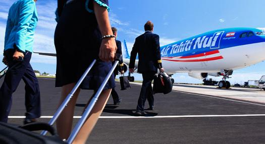 2 Pilots and 2 flight attendants walking on the Tarmac with Air Tahiti Nui Airbus in the background