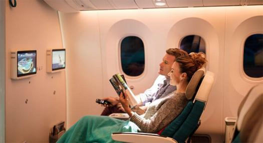Couple relaxing in aboard the Air Tahiti Nui Dreamliner