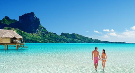 couple walking in the lagoon of bora bora
