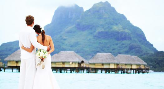 Couple watching the mountaign of bora bora