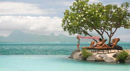 Family Playing Poolside in Tahiti