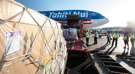 Air Fret container being loaded onboard of Air Tahiti Nui Aircraft on Tahiti International airport tarmac
