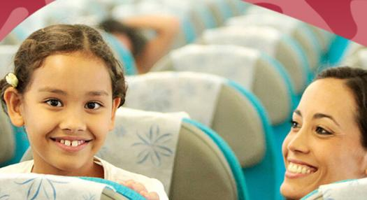 young girl smiling in air tahiti nui flight