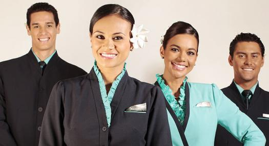 A photo of 4 smiling flight attendants of Air Tahiti Nui