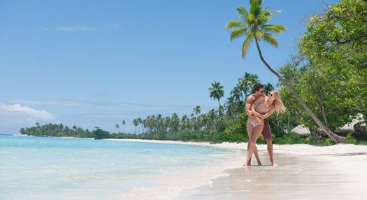 couple playing on the beach in Tahiti