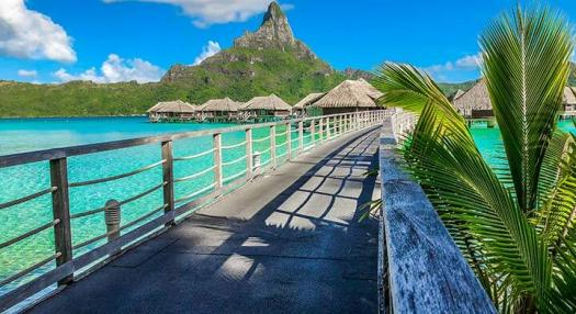 view of bora bora lagoon and overwater bungalow