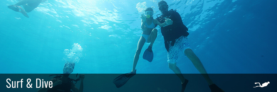 family diving in the lagoon of the islands of tahiti